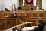 El consejero de Hacienda y Administraciones Públicas, Juan Alfonso Ruiz Molina, durante su intervención en el debate general relativo a la incidencia para Castilla-La Mancha de la propuesta de armonización fiscal anunciada por el Gobierno de España.